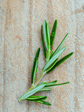 Branch of fresh rosemary  on shabby wooden background with flat lay. - 174809543