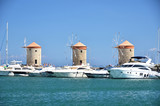 Windmills in the port of Rhodes, Greece - 174816765
