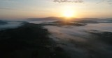 Panoramic video of dreamy foggy valley during sunrise. Ochodzita mountain, Koniakow, Silesian Beskid in Poland - 174825517