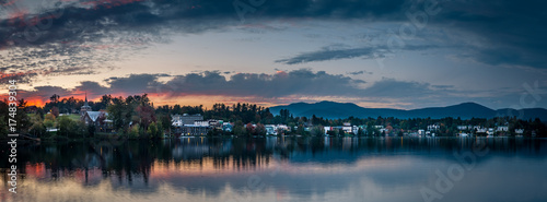 A panoramic view of the village of Lake Placid as seen from across Mirror Lake at sunset - 174839304