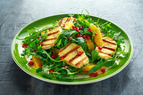 Grilled Halloumi Cheese salad with orange, rocket leaves, pomegranate and pumpkin seed. healthy food - 174843366