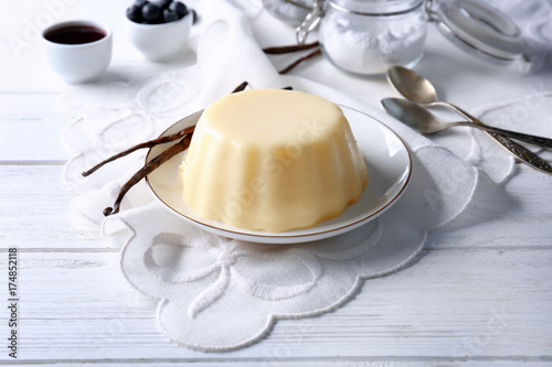 Fotobehang Kruiden 2 Plate with delicious vanilla pudding on wooden table