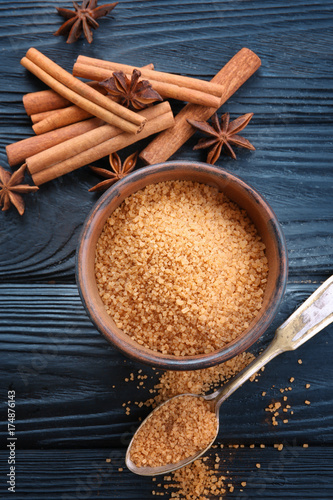 Fotobehang Kruiden 2 Beautiful composition with cinnamon sugar on wooden background
