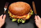 Huge giant big burger on a dark background close-up - 174876512