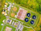 Aerial view to sewage treatment plant in green fields. Grey water recycling. Waste management for 165, 000 inhabitants of Pilsen city in Czech Republic, Europe.  - 174879185