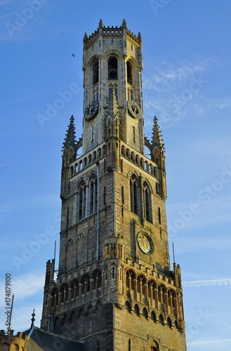 Deurstickers Brugge The landmark Belfry of Bruges, a medieval belltower in Belgium