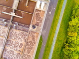 Aerial view to sewage treatment plant in green fields. Grey water recycling. Waste management for 165, 000 inhabitants of Pilsen city in Czech Republic, Europe.  - 174879539