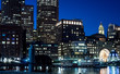 Night skyline from the harborwalk in Boston Seaport