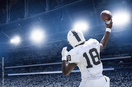 Leinwandbild Motiv Quarterback throwing a football in a professional football game