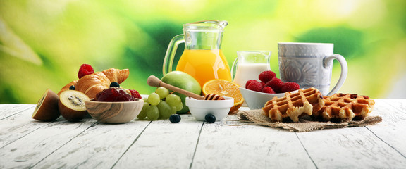 Breakfast served with coffee, orange juice, croissants and fruits. Balanced diet. © beats_
