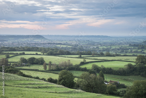 Beautiful dawn landscape over Somerset Levels in English countryside Poster