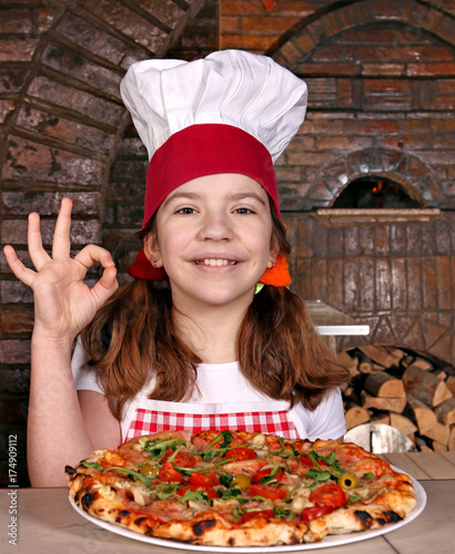 Foto op Canvas Pizzeria happy little girl cook with pizza and ok hand sign