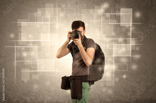 Male holdig professional camera with lens Poster
