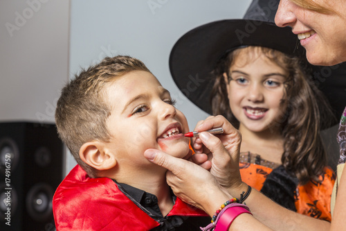 Mother painting faces at Halloween