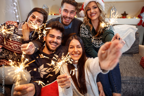 Cheerful group of people with sparkles together