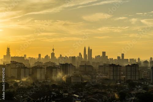 Majestic sunset over silhouette of downtown Kuala Lumpur, Malaysia Poster