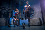 Couple training in a gym - 174928366