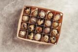 Quail eggs in a wooden box - 174929781