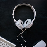headphones with cable on a black table - 174932307