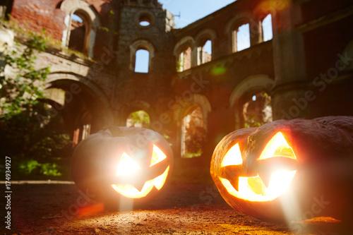 Traditional halloween jack-o-lanterns on the ground