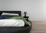 Round double bed in spacious bedroom - 174940721