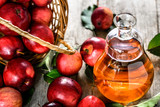 Wine bottle or apple cider vinegar, healthy detox drink with organic red apples on table - 174944512