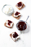 Canapes with cherry marmalade and soft cheese - 174945704