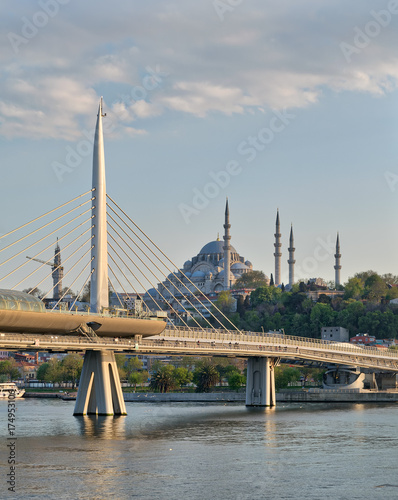 Day shot of Golden Horn Metro Bridge overlapping Suleymaniye Mosque, Istanbul, T Poster