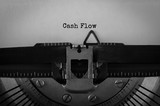 Text Cash Flow typed on retro typewriter - 174957399