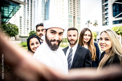 Fotobehang Abu Dhabi Arabic and western business people