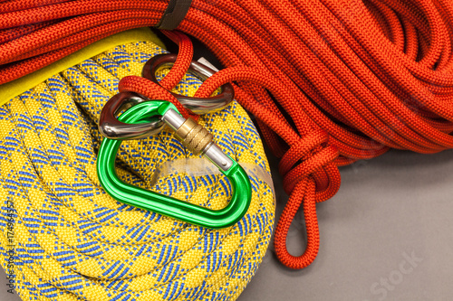 Red and yellow dynamic ropes and attached carabiner Poster