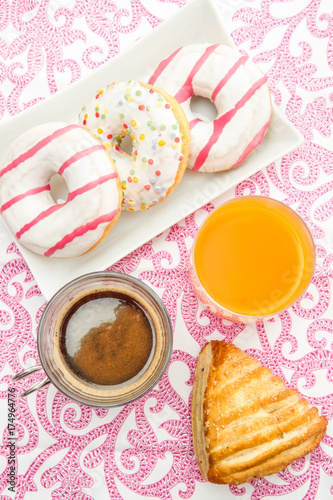 tablee with donuts and brioche breakfast Poster