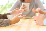 Three friends hands talking in a bar - 174965575