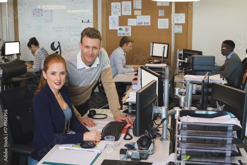 Fridge magnet Portrait of young business colleagues working on computer at