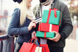 Picture of couple shopping for Christmas in the city - 174967577