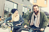 Young couple riding bikes and having fun in the city - 174967707