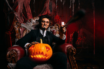 vampire with a pumpkin
