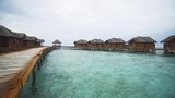 Thatched Roof Bungalows on a Pier in the Maldives - 174972948