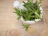 Fresh raw and dry rosemary on rustic background. - 174976944