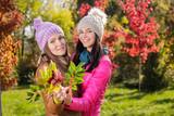 Two women in autumn park - 174976950