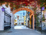 Gate to the winter tme in medieval town. Concept image symbolizing  season year changes - 174978318