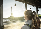 woman tourist in front of the Eiffel Tower in Paris, France - 174980109