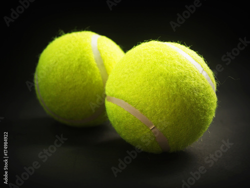 Two Tennis Ball closeup on black background