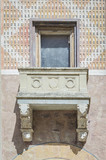 Front glass windows with balcony of an old medieval house - 174985121