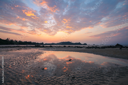 Fotobehang Strand Colourful sunset or sunrise over sea and waves as background