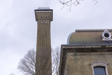 Old house with a tower/chimney in Battersea London - 174986980