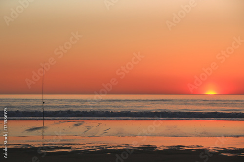 In de dag Koraal Colourful sunset or sunrise over sea and waves as background