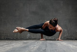 Young beautiful yoga female posing in studio - 174987363