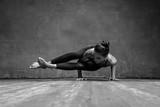 Young beautiful yoga female posing in studio - 174987385