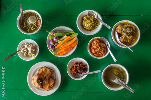 Top view at the table with assorted burmese food in local restaurant in Myanmar Poster